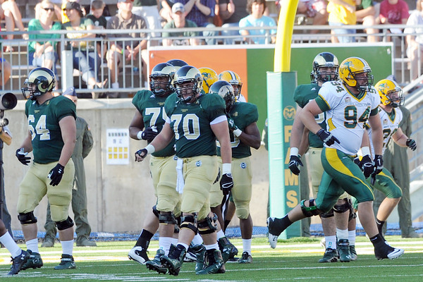 Colorado State offensive linemen walk off the field after allowing a safety during a game against North Dakota State on Saturday, Sept. 8, 2012 at Hughes Stadium.