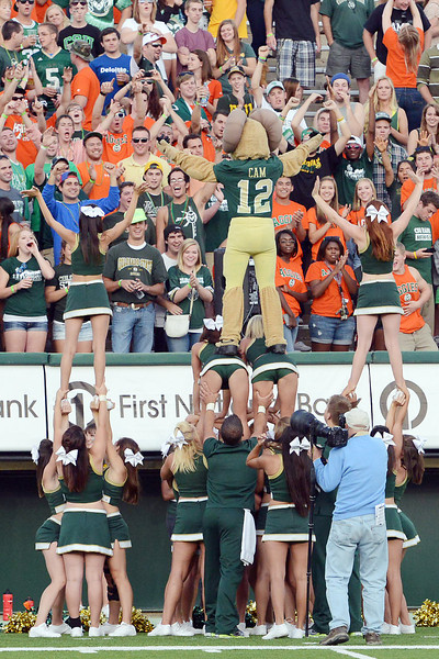 Colorado State University mascot Cam the Ram stands atop a human pyramid during a football game against Utah State on Saturday, Sept. 22, 2012 at Hughes Stadium in Fort Collins.