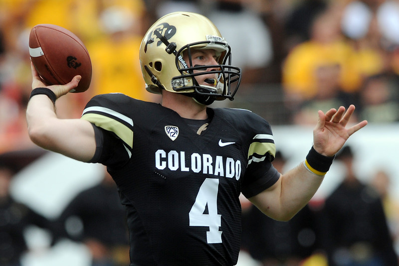 Colorado quarterback Jordan Webb rears back before throwing a pass in the first quarter of a game against Colorado State on Saturday, Sept. 1, 2012 at Sports Authority Field at Mile High. (Steve Stoner/Loveland Reporter-Herald)