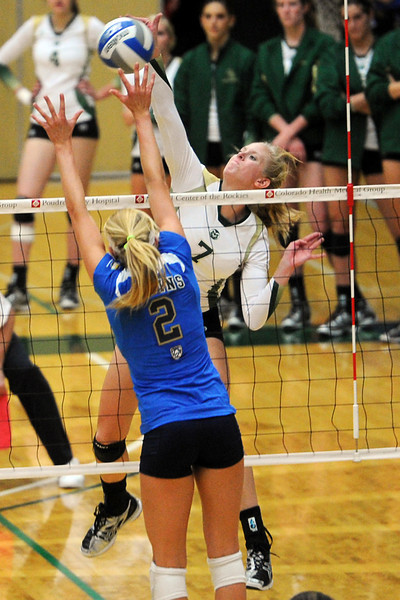 Colorado State's Kelsey Snider (7) spikes the ball over UCLA's Kelly Reeves during set two of their match Saturday, Sept. 15, 2012 at Moby Arena.