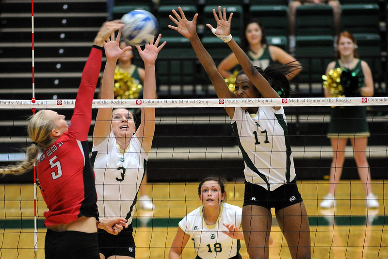 Colorado State University's Adrianna Culbert (3) and Brieon Paige (17) go up for a block while teammate Deedra Foss 18) looks on during their match against San Diego State on Saturday, Sept. 29, 2012 at Moby Arena in Fort Collins, Colo.
