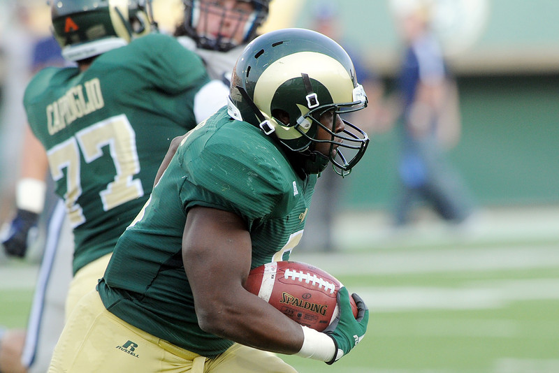 Colorado State University running back Chris Nwoke cuts through a hole in the first quarter of a game against Utah State on Saturday, Sept. 22, 2012 at Hughes Stadium in Fort Collins.