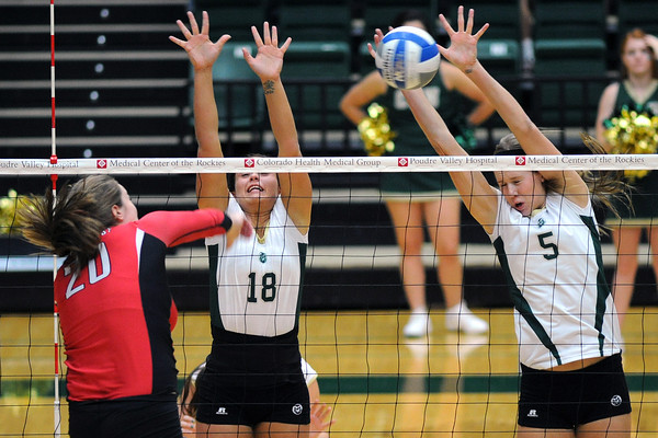 Colorado State University teammates Megan Plourde (5) and Deedra Foss (18) go up to block a spike by San Diego State's Raegan Shelton (20) during set two of their match on Saturday, Sept. 29, 2012 at Moby Arena in Fort Collins, Colo.