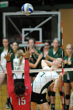 Colorado State University's Kelsey Snider (7) spikes the ball over San Diego State's Chaiymin Steel (15) during set two of their match on Saturday, Sept. 29, 2012 at Moby Arena in Fort Collins, Colo.