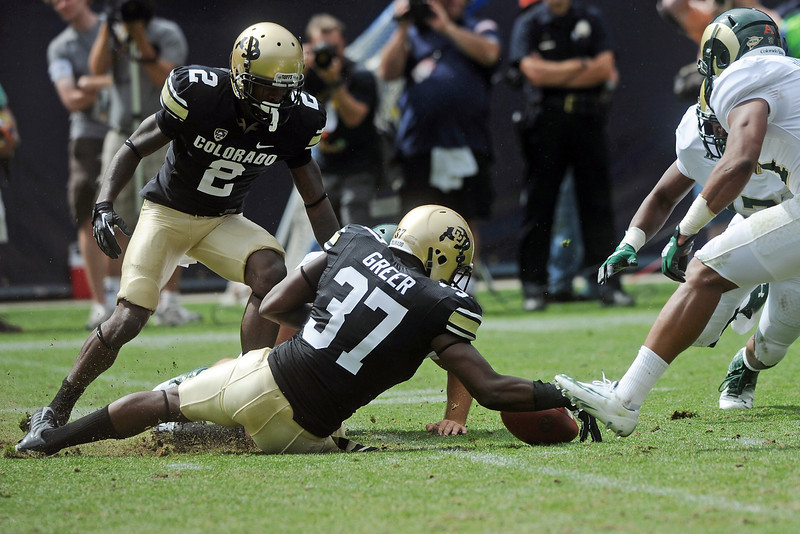 Colorado's Woodson Greer (37) scoops up the ball after teammate Kenneth Crawley (2) mishandled the catch on a punt return during a game against Colorado State on Saturday, Sept. 1, 2012 at Sports Authority Field at Mile High. (Steve Stoner/Loveland Reporter-Herald)