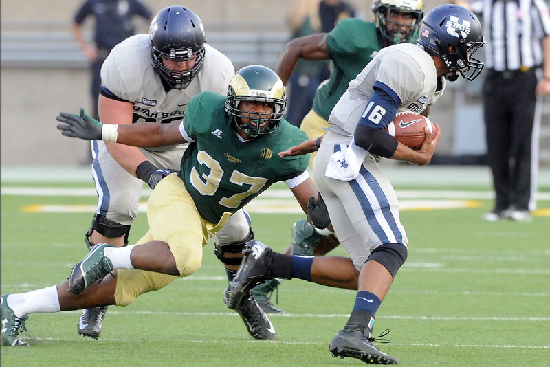 Colorado State University linebacker Aaron Davis (37) pursues Utah State quarterback Chuckie Keeton during their game on Saturday, Sept. 22, 2012 at Hughes Stadium in Fort Collins.