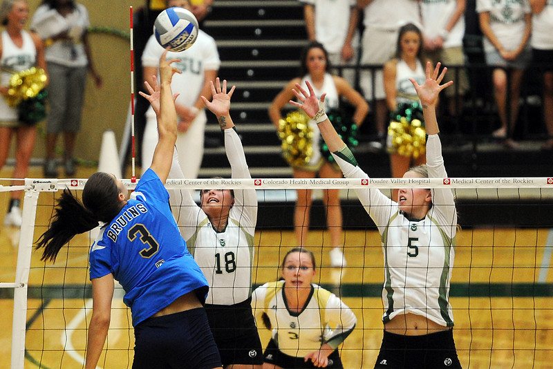 Colorado State's Megan Plourde (5) and Deedra Foss (18) attempt block UCLA's Tabi Love while Adrianna Culbert, back, looks on during set two of their match Saturday, Sept. 15, 2012 at Moby Arena.