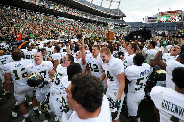 Colorado State football players celebrate their victory against Colorado on Saturday, Sept. 1, 2012 at Sports Authority Field at Mile High. The Rams defeated the Buffs, 22-17.