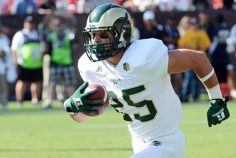 Colorado State's Joe Hansley runs for a touchdown in the second half of a game against Colorado on Saturday, Sept. 1, 2012 at Sports Authority Field at Mile High.