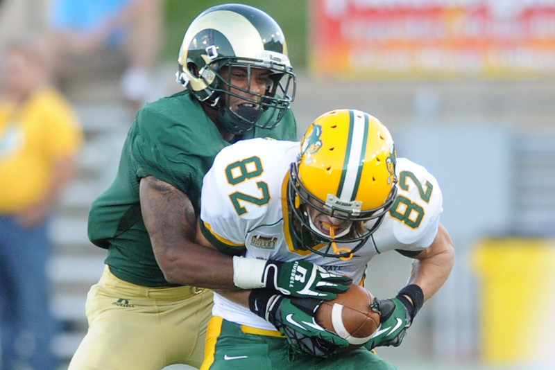 North Dakota State wide receiver Zach Vraa (82) hauls in a catch in front of Colorado State cornerback Momo Thoms in the second quarter of their game Saturday, Sept. 9, 2012 at Hughes Stadium.