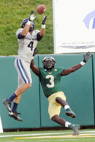 Utah State University wide receiver Matt Austin (4) catches a touchdown pass in the end zone over Colorado State defensive back Shaq Bell in the second quarter of their game on Saturday, Sept. 22, 2012 at Hughes Stadium in Fort Collins.