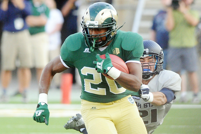 Colorado State University running back Tommy Morris (20) avoids the grasp of Utah State's Brian Suite in the second quarter of their game on Saturday, Sept. 22, 2012 at Hughes Stadium in Fort Collins.