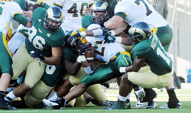 North Dakota State running back John Crocket, middle, is stopped by a host of Colorado State defenders on second and goal play in the first quarter of their game Saturday, Sept. 8, 2012 at Hughes Stadium.