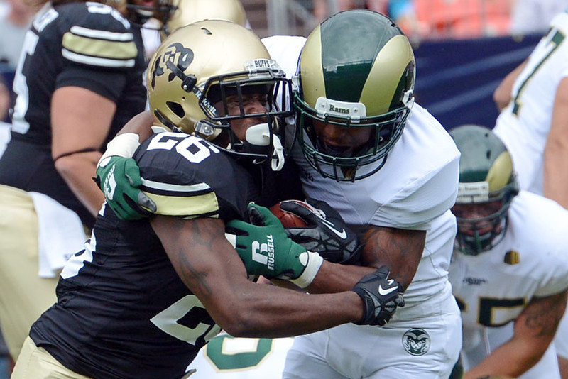 Colorado running back Tony Jones, left, is wrapped up by Colorado State cornerback Momo Thomas on a run play in the first quarter of their game on Saturday, Sept. 1, 2012 at Sports Authority Field at Mile High. (Steve Stoner/Loveland Reporter-Herald)