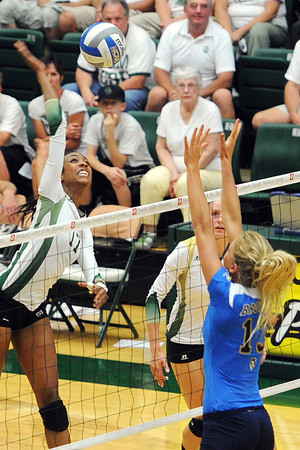 Colorado State's Brieon Paige, left, goes up for a spike while teammate Dana Cranston looks on during set one of their match against UCLA on Saturday, Sept. 15, 2012 at Moby Arena.