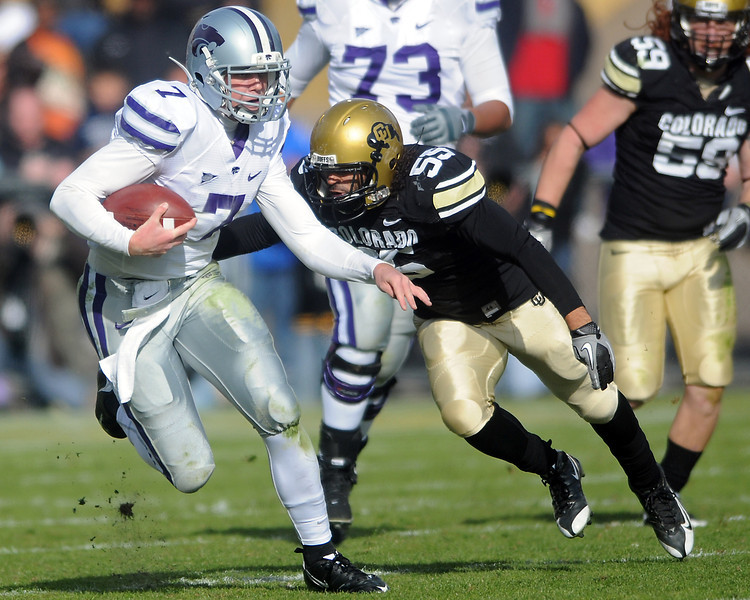 Kansas State University quarterback and Loveland High School graduate Collin Klein (7) is pursued by Colorado defender Josh Hartigan (55) in the second quarter of their game on Saturday, Nov. 20, 2010 at Folsom Field in Boulder.