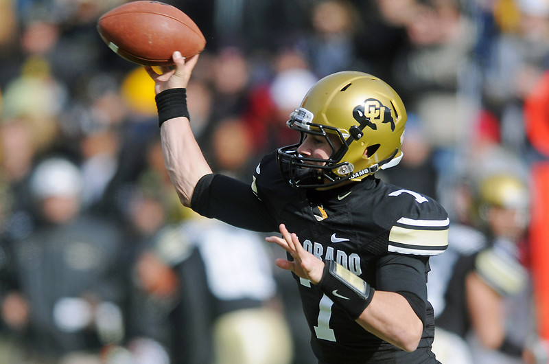 University of Colorado quarterback Cody Hawkins throws a pass in the second quarter of a game against Kansas State on Saturday, Nov. 20, 2010 at Folsom Field in Boulder.