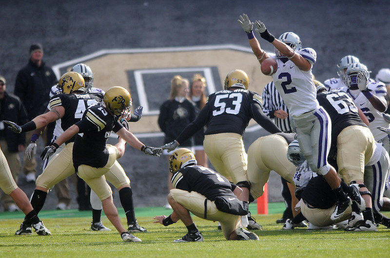 University of Colorado kicker Aric Goodman (13) has his extra point attempt blocked by Kansas State's Chris Harper (2) in the first quarter of their game on Saturday, Nov. 20, 2010 at Folsom Field in Boulder.