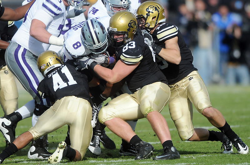 University of Colorado defenders Terrel Smith (41), Will Pericak (83) and Travis Sandersfeld (19) combine to tackle Kansas State running back Daniel Thomas (8) in the second quarter of their game on Saturday, Nov. 20, 2010 at Folsom Field in Boulder.