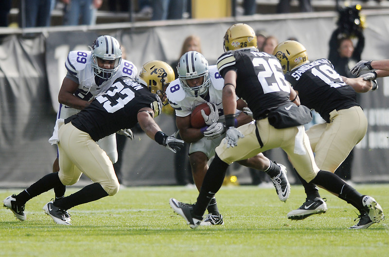 University of Colorado defenders Jalil Brown (23), Ray Polk (26) and Travis Sandersfeld (19) converge on Kansas State running back Daniel Thomas (8) while Aubrey Quarles (89) throws a block in the first quarter of their game on Saturday, Nov. 20, 2010 at Folsom Field in Boulder.