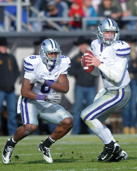 Kansas State University quarterback Collin Klein (7) drops back to pass after faking the handoff to running back Daniel Thomas (8) in the second quarter of a game against Colorado on Saturday, Nov. 20, 2010 at Folsom Field in Boulder.