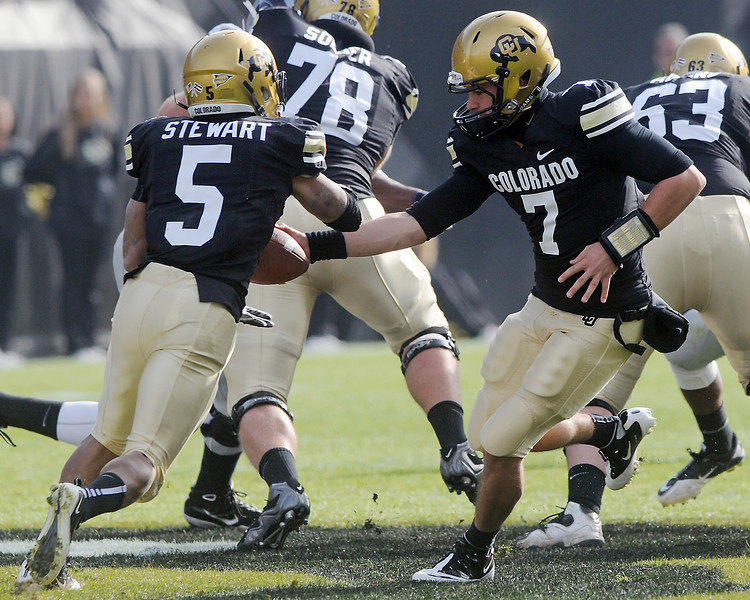 University of Colorado quarterback Cody Hawkins (7) hands the ball off to running back Rodney Stewart in the first quarter of their game against Kansas State on Saturday, Nov. 20, 2010 at Folsom Field in Boulder.
