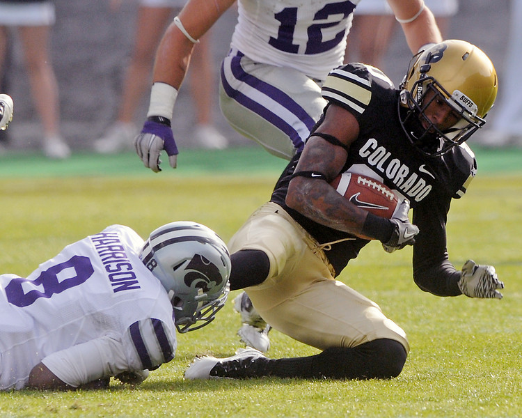 University of Colorado wide receiver Paul Richardson is tackled by Kansas State's Stephen Harrison after making a catch in the first quarter of their game on Saturday, Nov. 20, 2010 at Folsom Field in Boulder.