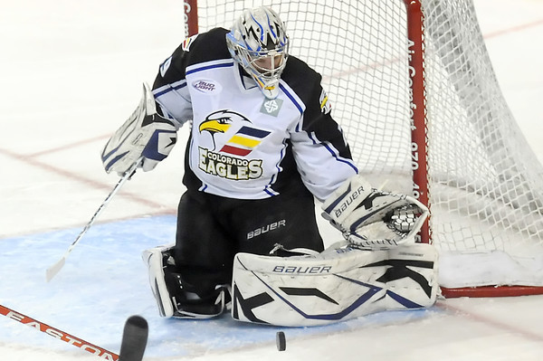 Colorado Eagles goalie Kyle Jones makes a stop in the first period of a game against the Quad City Mallards on Friday, April 1, 2011 at the Budweiser Events Center.