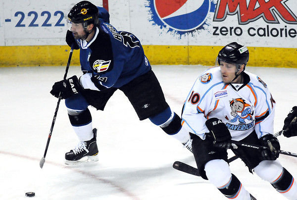 Colorado Eagles center Adam Hogg skates away from Missouri Mavericks forward Mike Berry during a game in February at the Budweiser Events Center.