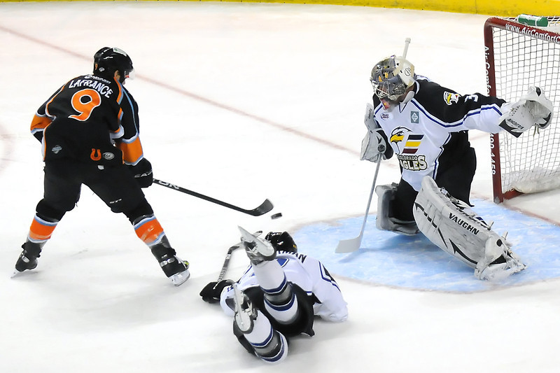 Colorado Eagles goalie Andrew Penner and defenseman Kip Workman combine to stop a shot by Missouri Mavericks forward Toby Lafrance in the first period of their game Friday, April 15, 2011 at the Budweiser Events Center in Loveland, Colo.