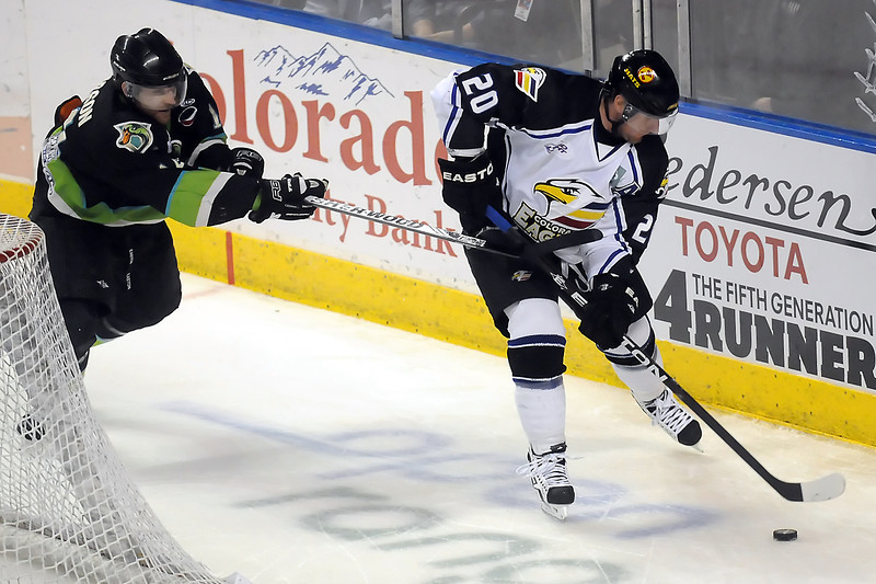 Colorado Eagles defenseman Jason Beatty (20) tracks down the puck ahead of Quad City Mallards winger Zac Pearson in the first period of their game Friday, April 1, 2011 at the Budweiser Events Center.