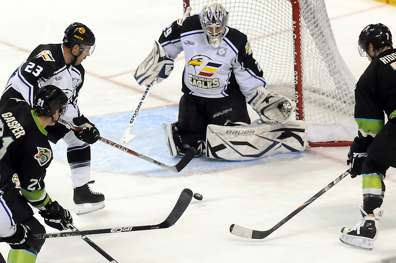 Colorado Eagles goalie Kyle Jones eyes the puck before making a stop in the first period of a game against the Quad City Mallards on Friday, April 1, 2011 at the Budweiser Events Center.