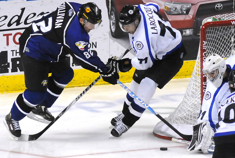 Colorado Eagles forward Dan Sullivan, left, battles against Evansville Icemen defenseman Mario Larocque during a game in January at the Budweiser Events Center.