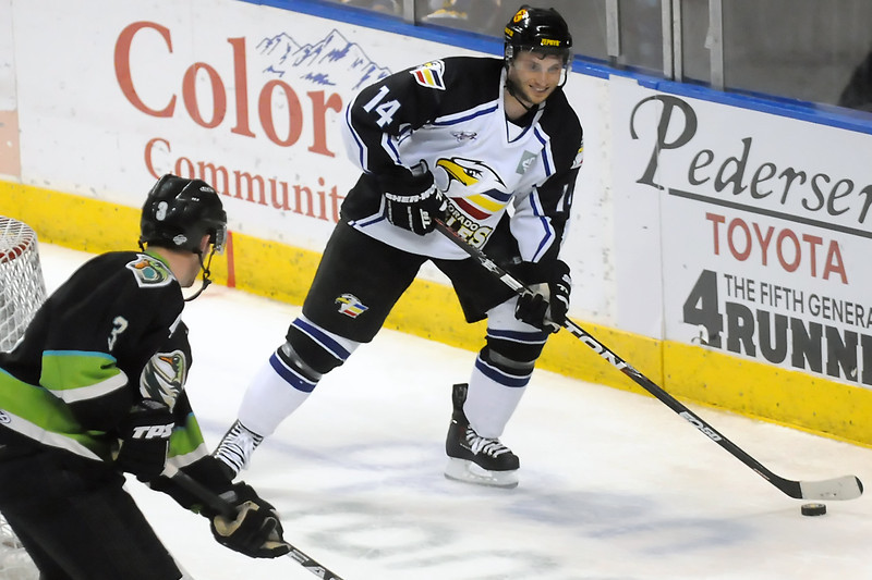 Colorado Eagles forward Daymen Rycroft (14) works  behind then net against Quad-City Mallards defenseman Bob Preece in the second period of their game Saturday, April 2, 2011 at the Budweiser Events Center.