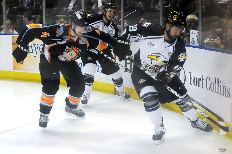 Colorado Eagles players Adam Hogg, right, and Steve Haddon work against Missouri Mavericks defenseman Steven Later in the second period of their game Friday, April 15, 2011 at the Budweiser Events Center in Loveland, Colo.