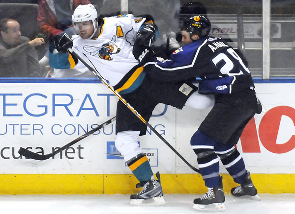 Colorado Eagles forward A.J. Hau, right, battles against the boards with Rio Grande Valley Killer Bees defenseman Rob Cowan during a game in March at the Budweiser Events Center.