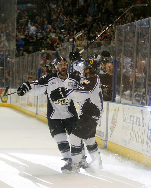 Colorado Eagles' Steve Haddon celebrates with Aaron Schneekloth after scoring a hat trick in  the second period against the Missouri Mavericks on Saturday night at Budweiser Events Center in Loveland.(Photo by Gabriel Christus)