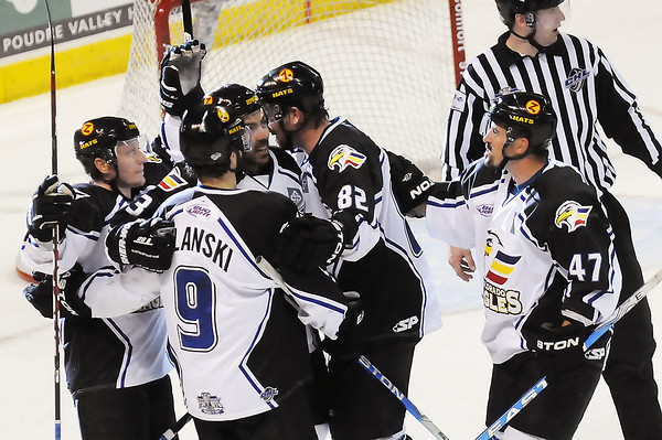 Colorado Eagles players celebrate after a first-period goal by Kevin Ulanski (9) during their playoff game against the Missouri Mavericks on Friday, April 15, 2011 at the Budweiser Events Center.