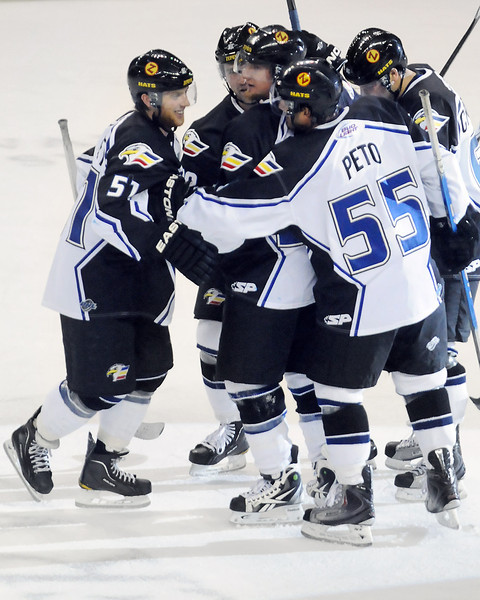 Colorado Eagles players celebrate after forward Dylan Stanley, left, scored a goal in the first period of a game against the Odessa Jackalopes on Friday at the Budweiser Events Center.
