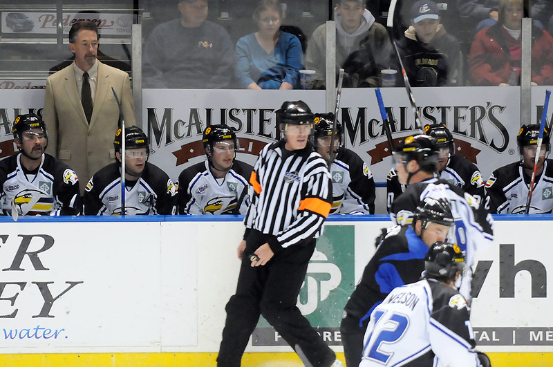 Colorado Eagles head coach Chris Stewart, back left, works behind the bench during a game against the Wichita Thunder on Nov. 26, 2010 at the Budweiser Events Center.