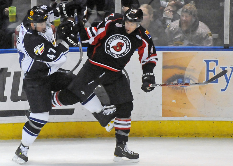 Colorado Eagles forward Scott May, left, collides with Arizona Sundogs defenseman Maxime Renaud during a game last December at the Budweiser Events Center.