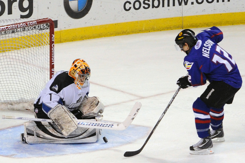 Colorado Eagles forward Riley Nelson takes a shot on Idaho Steelheads goalie Bryan Hince in the first period of their game on Wednesday, Feb. 15, 2012 at the Budweiser Events Center.