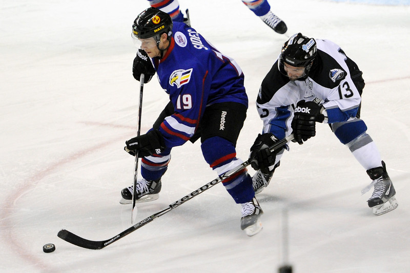 Colorado Eagles forward Joey Sides, left, tracks down the puck in front of Idaho Steelheads forward Ian Lowe in the first period of their game on Wednesday, Feb. 15, 2012 at the Budweiser Events Center.