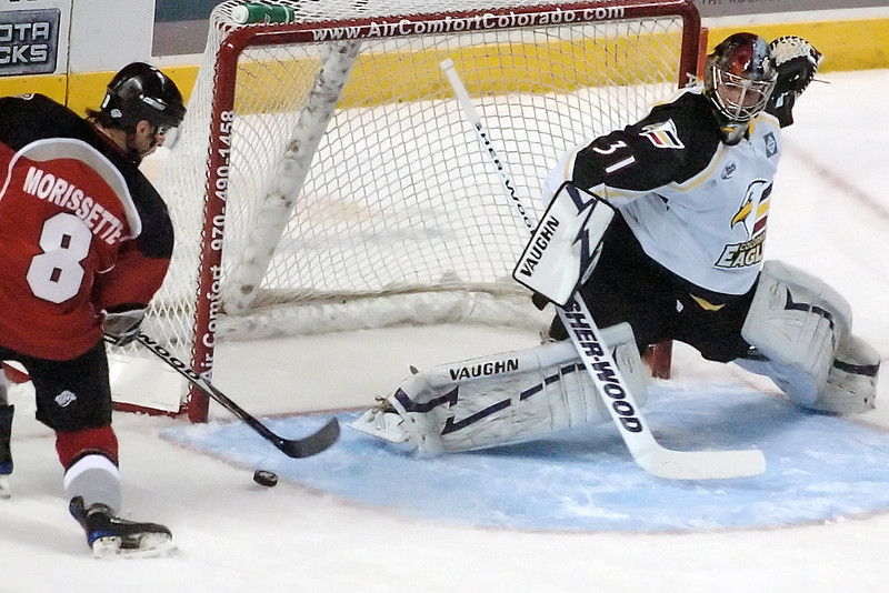 Colorado Eagles goalie Andrew Penner stretches out to make a save on a shot attempt by Amarillo Gorillas center Jake Morissette in the first period of their game Wednesday, Nov. 25, 2009 at the Budweiser Events Center.