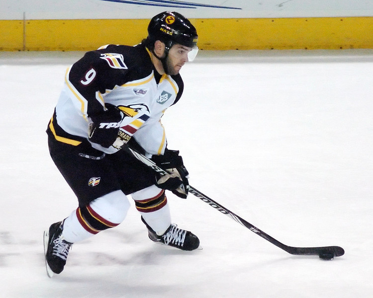 Colorado Eagles winger Kevin Ulanski skates with the puck in the first period of a game against the Amarillo Gorillas on Wednesday, Nov. 25, 2009 at the Budweiser Events Center.