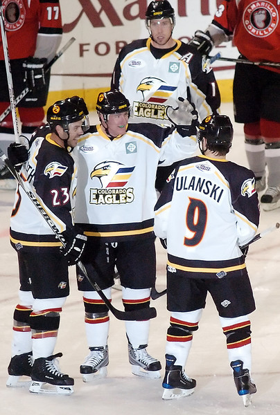 Colorado Eagles defenseman Jason Beatty, center, is congratulated by teammates after scoring a goal in the second period of a game against the Amarillo Gorillas on Wednesday, Nov. 25, 2009 at the Budweiser Events Center.