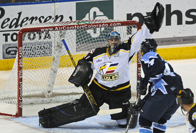 Colorado Eagles goalie Mike Mole stops a shot by Brent Ottmann of the Wichita Thunder during the first period of Wednesday night's game at the Budweiser Events Center.