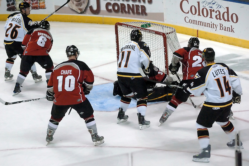 Colorado Eagles players Ryan McLeod (26), Ed McGrane (11) and Brett Lutes (14) during a game against the Amarillo Gorillas on Wednesday, Nov. 25, 2009 at the Budweiser Events Center.