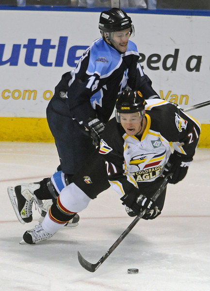 Jim Jorgensen of the Wichita Thunder battles with Colorado Eagle forward Fraser Filipic during the first period of Wednesday nights game at the Budweiser Events Center.