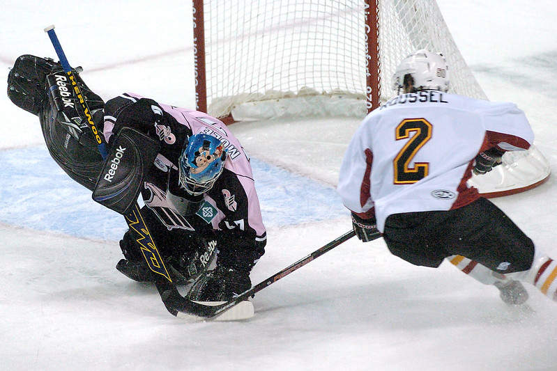 Colorado Eagles goalie Mike Mole makes a stop on a shot by Thomas Roussel of the Arizona Sundogs in the first period of their game on Friday, Oct. 9, 2009 at the Budweiser Events Center.